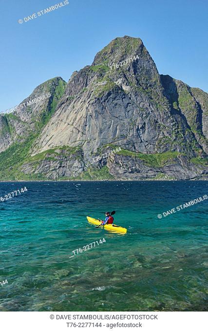 Kayaking the beautiful waters of the Reinefjord in the Lofoten Islands, Norway