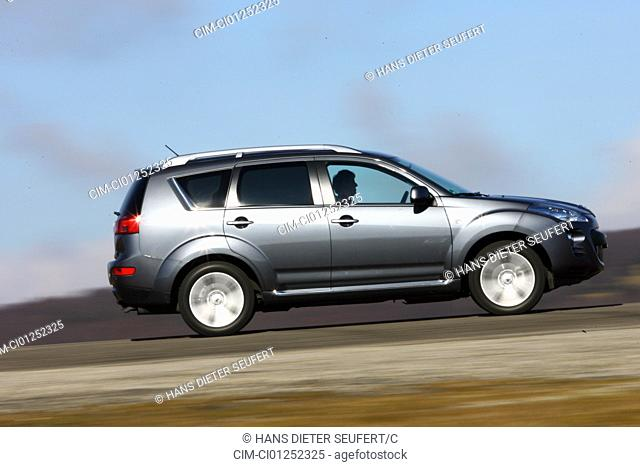 Peugeot 4007 HDi Platinum, model year 2007-, anthracite, driving, side view, country road