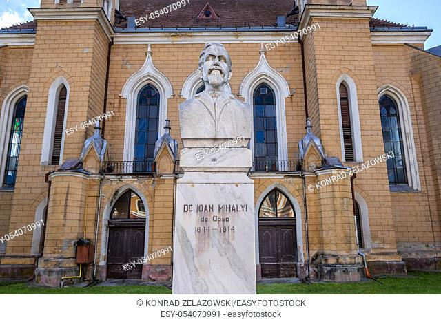 Dr Ioan Mihaly de Apsa statue in front of Reformed church in Sighetu Marmatiei city in Maramures County of northwestern Romania