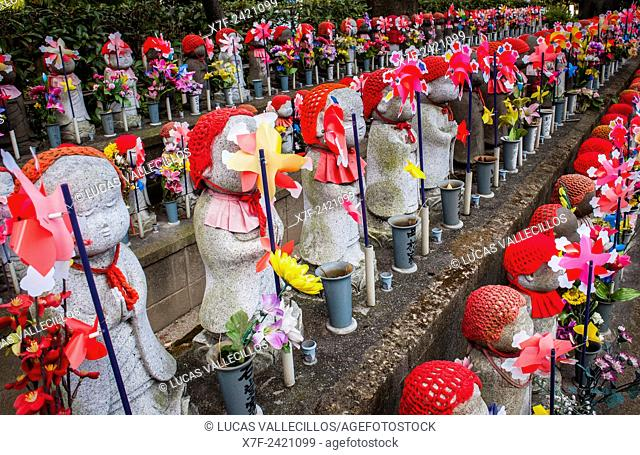 Statues of Jizo dedicated to dead unborn children, in Zojoji temple, Tokyo, Japan