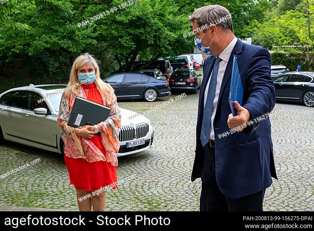 13 August 2020, Bavaria, Munich: Melanie Huml (CSU), Minister of State for Health and Care, and Markus Söder (CSU), Minister President of Bavaria