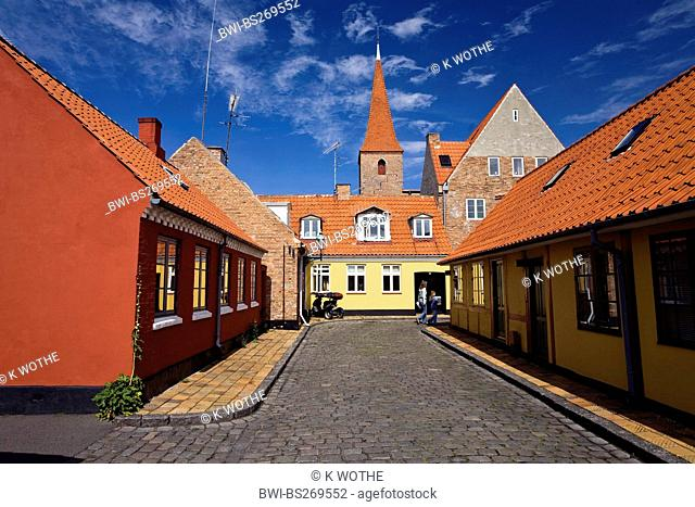 pictoresque alley with view at the steeple, Denmark, Bornholm, Roenne