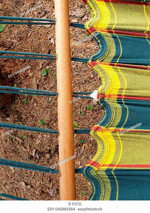 Hammock's attachments fixed and knotted to tree. Knots and strings knotted up. Equipment of hammock