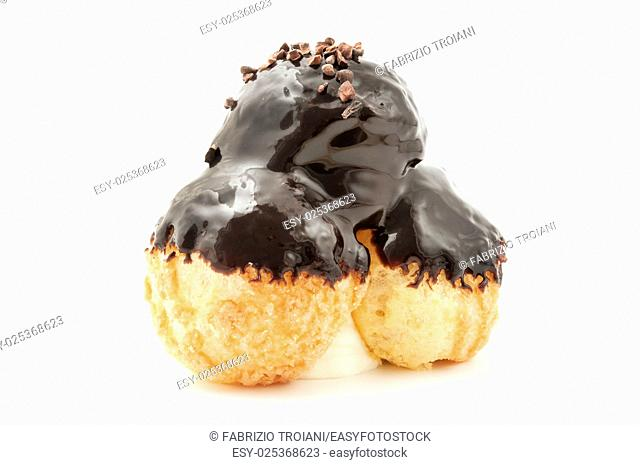 Profiterole with chocolate ganache on a white background