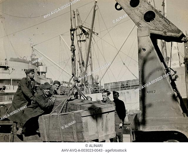 Foodstuffs & Munitions being unloaded in Naples Port: Italian troops arrive to unload ships, Naples, shot 1944
