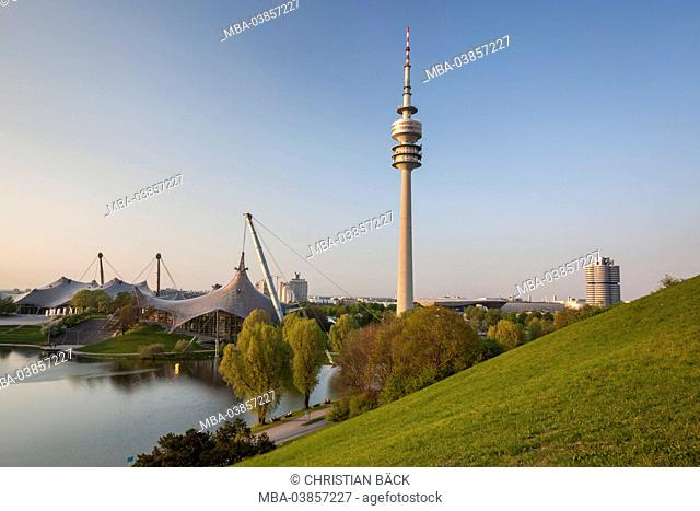 Olympic tower with Olympic lake in Olympic Park, Munich, Upper Bavaria, Bavaria, Germany