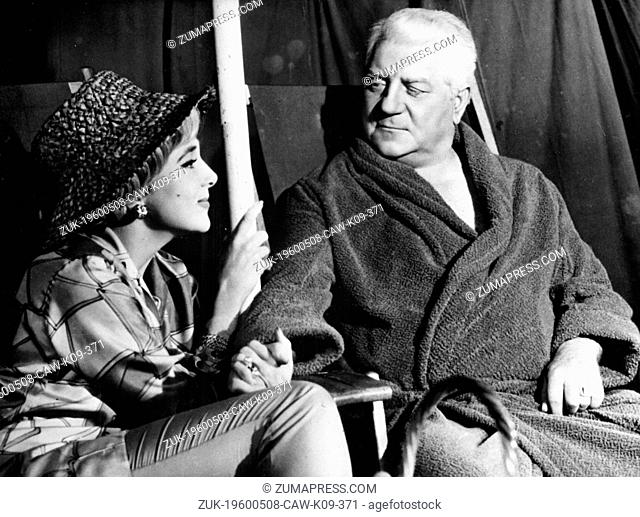 May 8, 1960 - Location Unknown - JEAN GABIN (1904-1976), was a famous actor and war hero. PICTURED: Jean Gabin and an actress in a film scene