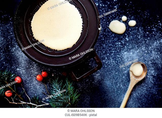 Batter on hotplate, making krumkake cookies, overhead view