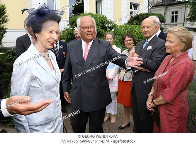 The British Princess Anne (L) speaks to Claus-Guether Budelmann at the Anglo-German club, of which he is the chairman, in Hamburg, Germany, 15 June 2017