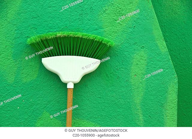green broom on green wall ,island of Burano Venice Italy