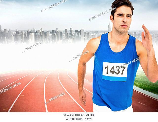 Male runner sprinting on track against blurry skyline