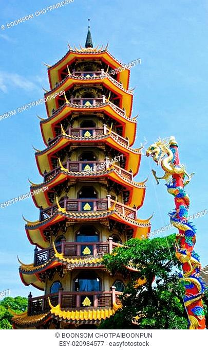 Chinese pagoda and dragon statue