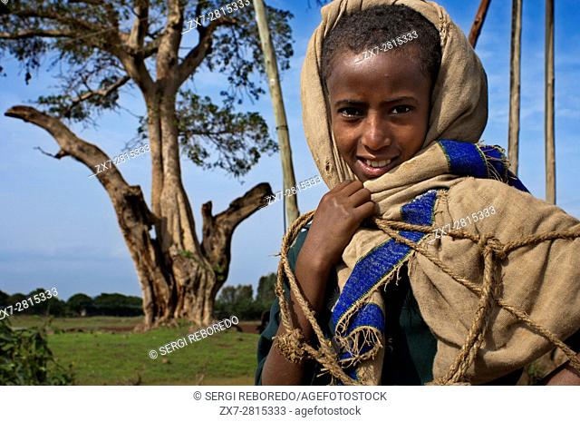 Portrait of a teenager near Bahir Dar airport, Ethiopia. From the port of Bahir Dar you can access by boat to several of the historic churches and monasteries...