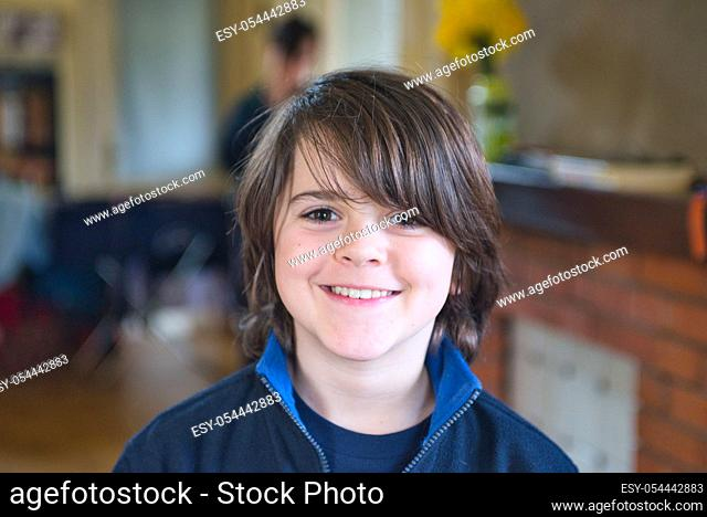 portrait of smiling child in own home