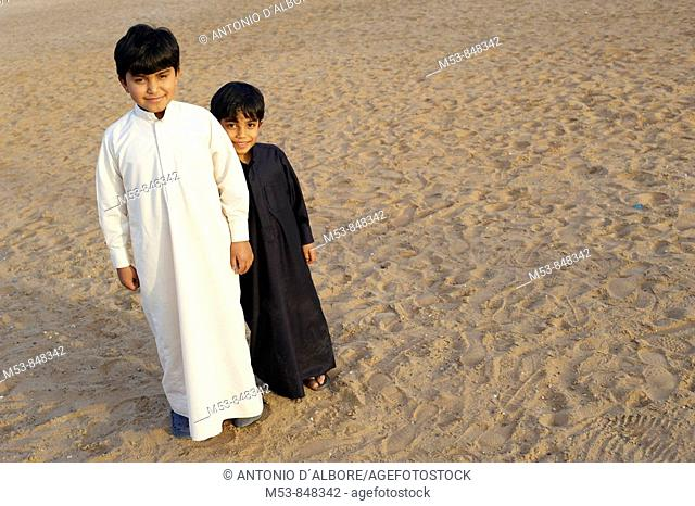 two brothers wearing traditional arabic clothes dubai united arabic emirates middle east