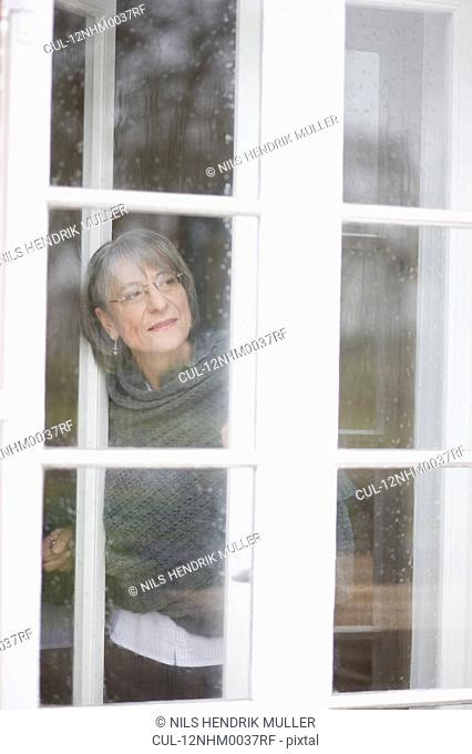 old woman looking out a window