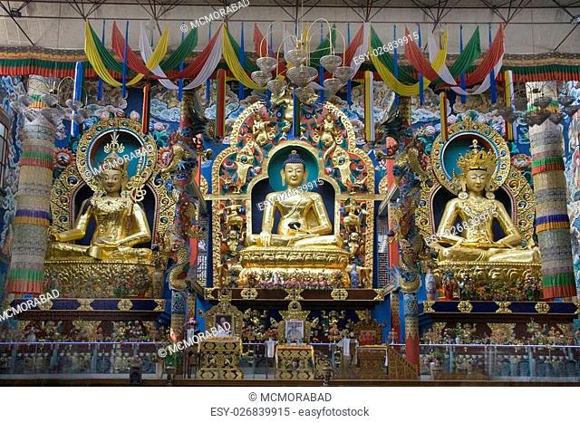 Lord Buddha at the centre, flanked by Lord Padmasambhava and Lord Amitayus on either side at Namdroling Monastery in Bylakuppe, near Kushalnagar