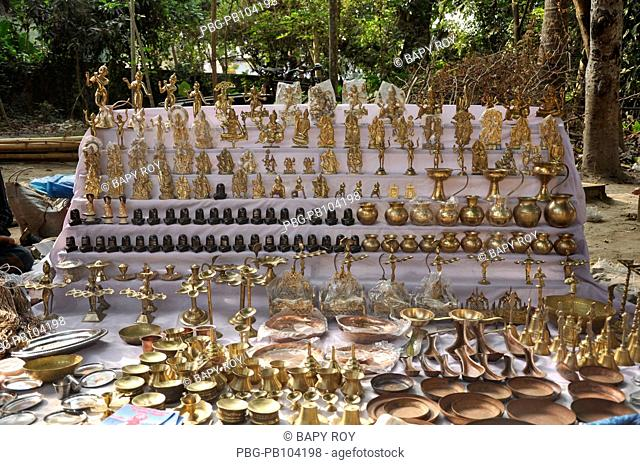 Products of goddess and Hindu religion culture made from brass are being sold at Boishaki Mela due to Bangla New Year Noboborsha or the Bangla New Year...