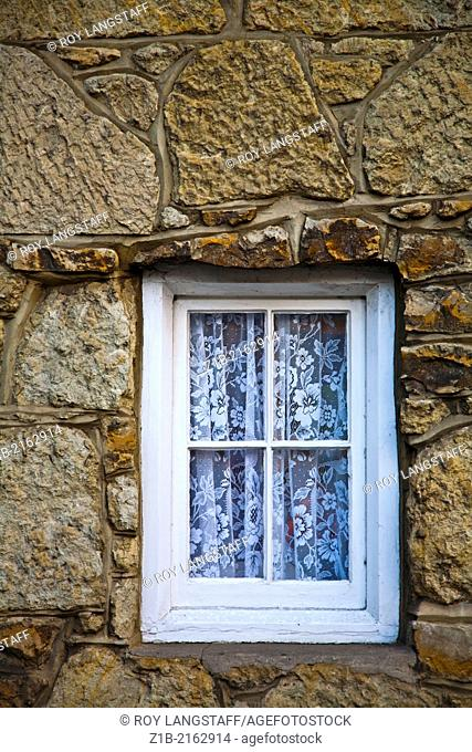 Abstract image of a small window in a stone wall, Shanklin, Isle of Wight, England