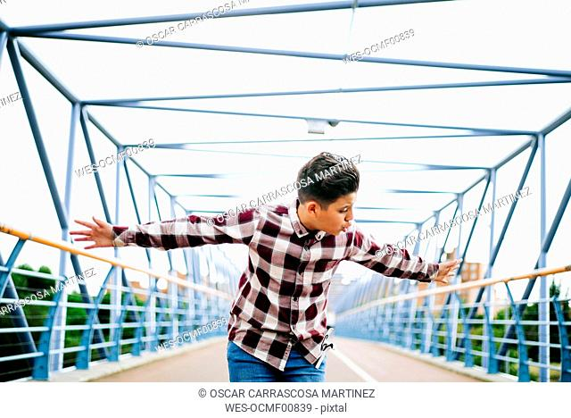 Gypsy boy singing flamenco on a bridge