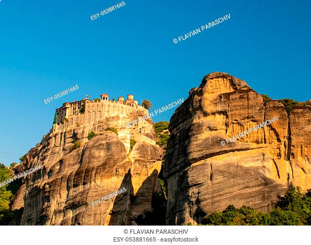 Monastery Meteora Greece. Stunning panoramic landscape. View of mountains and green forest against epic blue sky with clouds. UNESCO heritage object