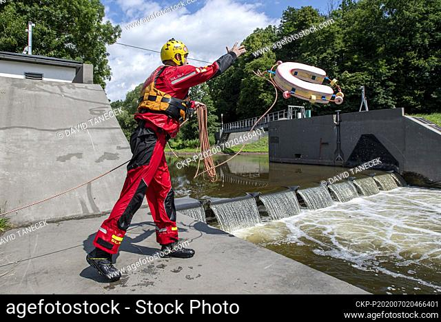 Petr Ptacek of Association of water tourism and sports shows saving a human life with a rescue horseshoe on the weir in Zlic, near Ceska Skalice, Czech Republic