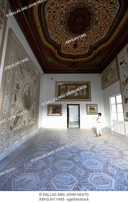 Africa, Tunisia, Tunis, Interior of Bardo Museum, Sightseer Viewing Roman Mosaics