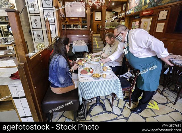 Illustration picture shows a waiter and clients at the famous Leon restaurant, with Belgian speciality molds and fries, Monday 08 June 2020