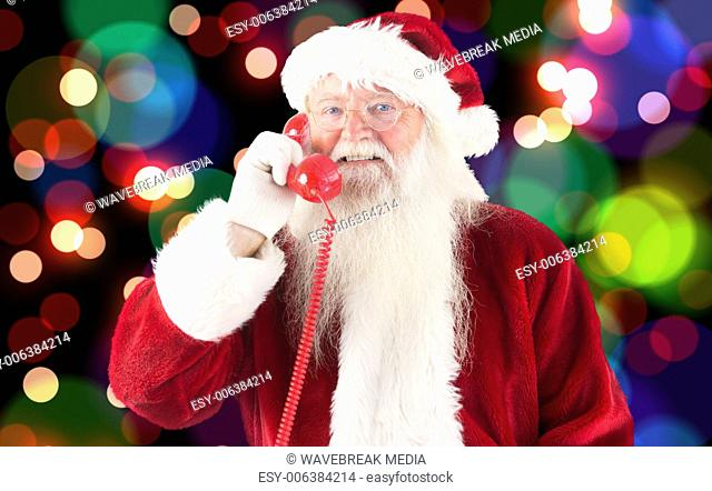 Composite image of santa claus on the phone