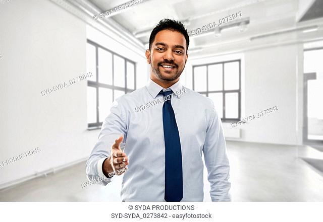 businessman or realtor giving hand for handshake