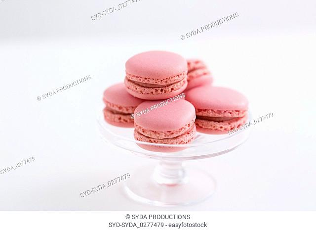 pink macarons on glass confectionery stand