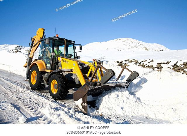 Charlie Middleton, an employee of cumbria vounty council clears snow from the blocked Kirkstone Pass, the highest mountain pass in the Lake District Last year...