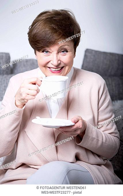 Portrait of a senior woman drinking coffee
