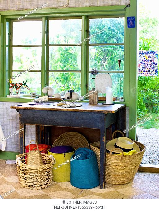 Patio with table and baskets