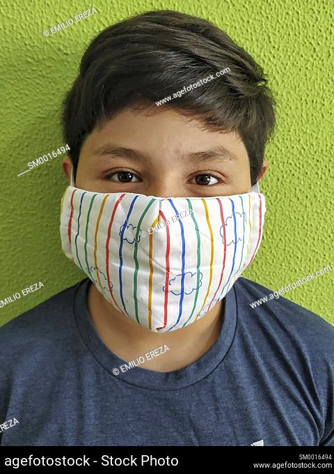 Little boy wearing a mask