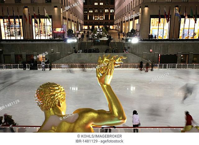 Ice skating rink, Rockefeller Center, statue of Prometheus, Manhattan, New York City, NY, United States of America