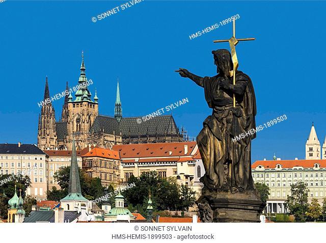 Czech Republic, Prague, historical centre listed as World Heritage by UNESCO, statue of St John the Baptist on Charles Bridge, Prague Castle