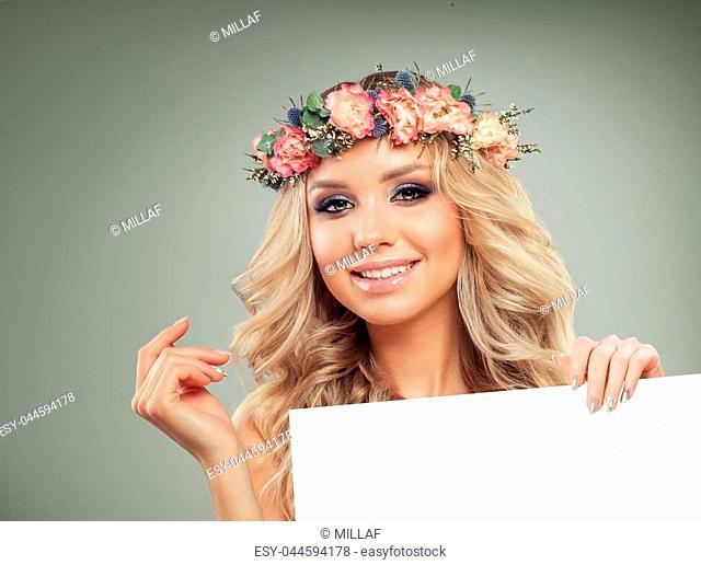 Young Smiling Woman with Blank Board Paper Background. Cheerful Girl with Flowers on Hair