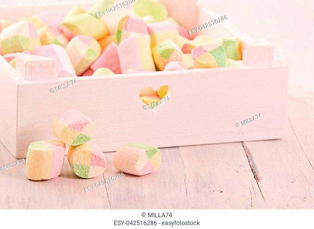 Marshmallows on wooden table
