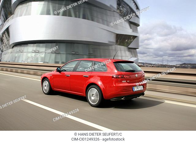 Alfa Romeo 159 roadster 3.2 JTS V6, red, model year 2006-, driving, diagonal from the back, rear view, country road
