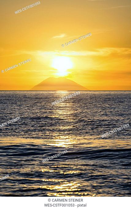 Italy, Sicily, Aeolian Islands, View to Isola Stromboli at sunset