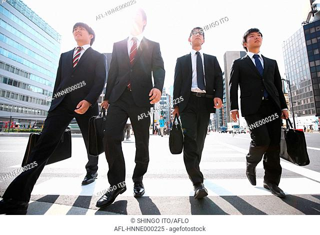 Young Japanese businessmen walking