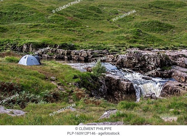 Wild camping with lightweight dome tent along the River Etive in Glen Etive near Glencoe in the Scottish Highlands, Scotland, UK