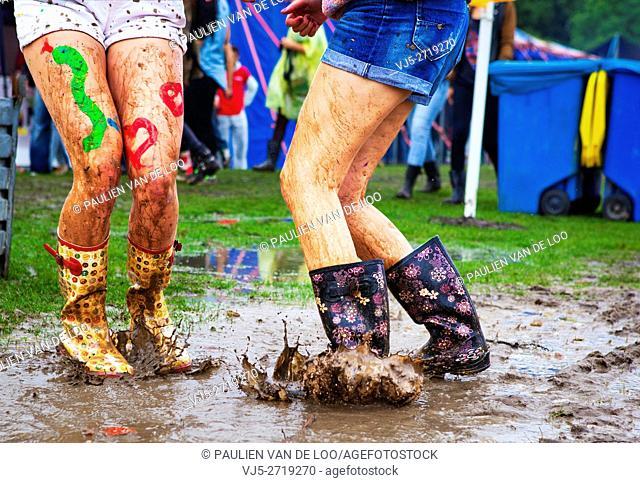 Utrecht, Netherlands, girls having fun while dancing and splashing in the rain