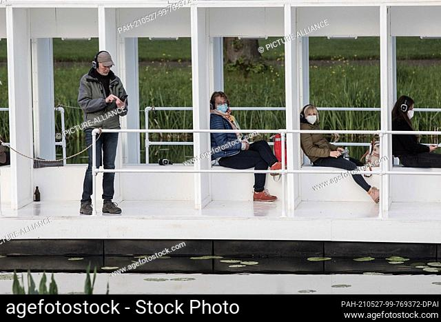 27 May 2021, Lower Saxony, Hanover: During the KunstFestSpiele Herrenhausen, members of the artist group YRD.Works will be sailing across the Graft in the Great...