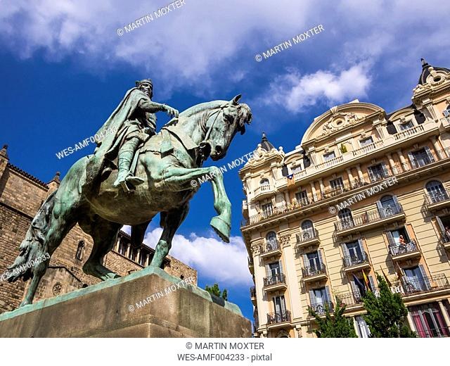 Spain, Barcelona, equestrian statue on Placa Ramon Berenguer el Gran and Cathedral