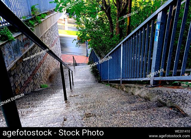 Stairs near the Road after Rainfall in Autumn