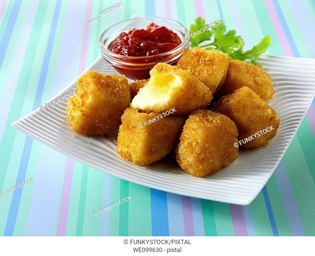 Deep fried camembert in bread crumbs with salad