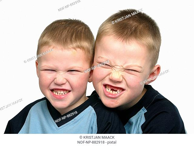 Close-up of two boys clenching their teeth