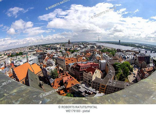 Fisheye aerial view of Riga city from st. Peter's church in Latvia. Panoramic view of Riga with cloudy blue sky. Fisheye lens